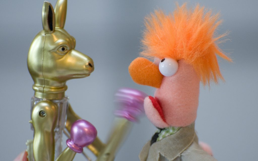 Home business networking hacks. A toy Kangaroo on the left punching a ginger haired Muppet